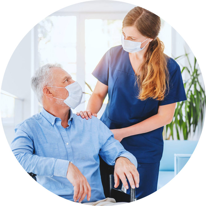 female caregiver and her senior man patient wearing face mask