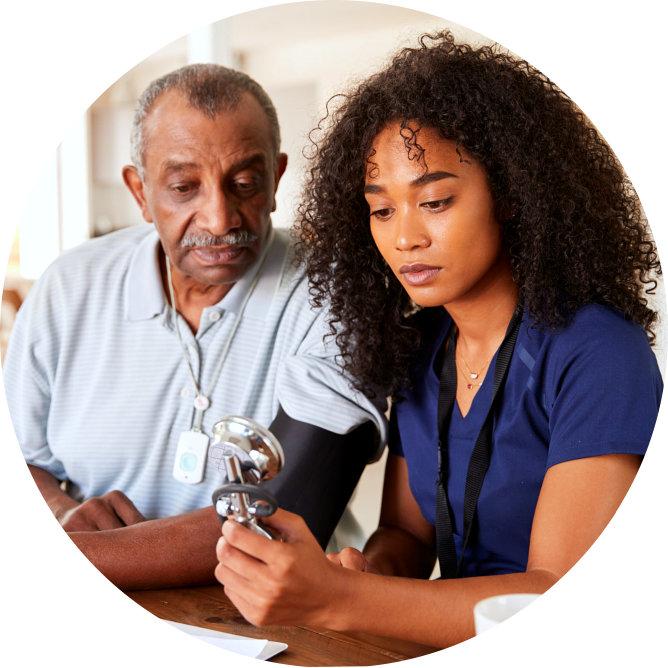 caregiver and her senior man patient